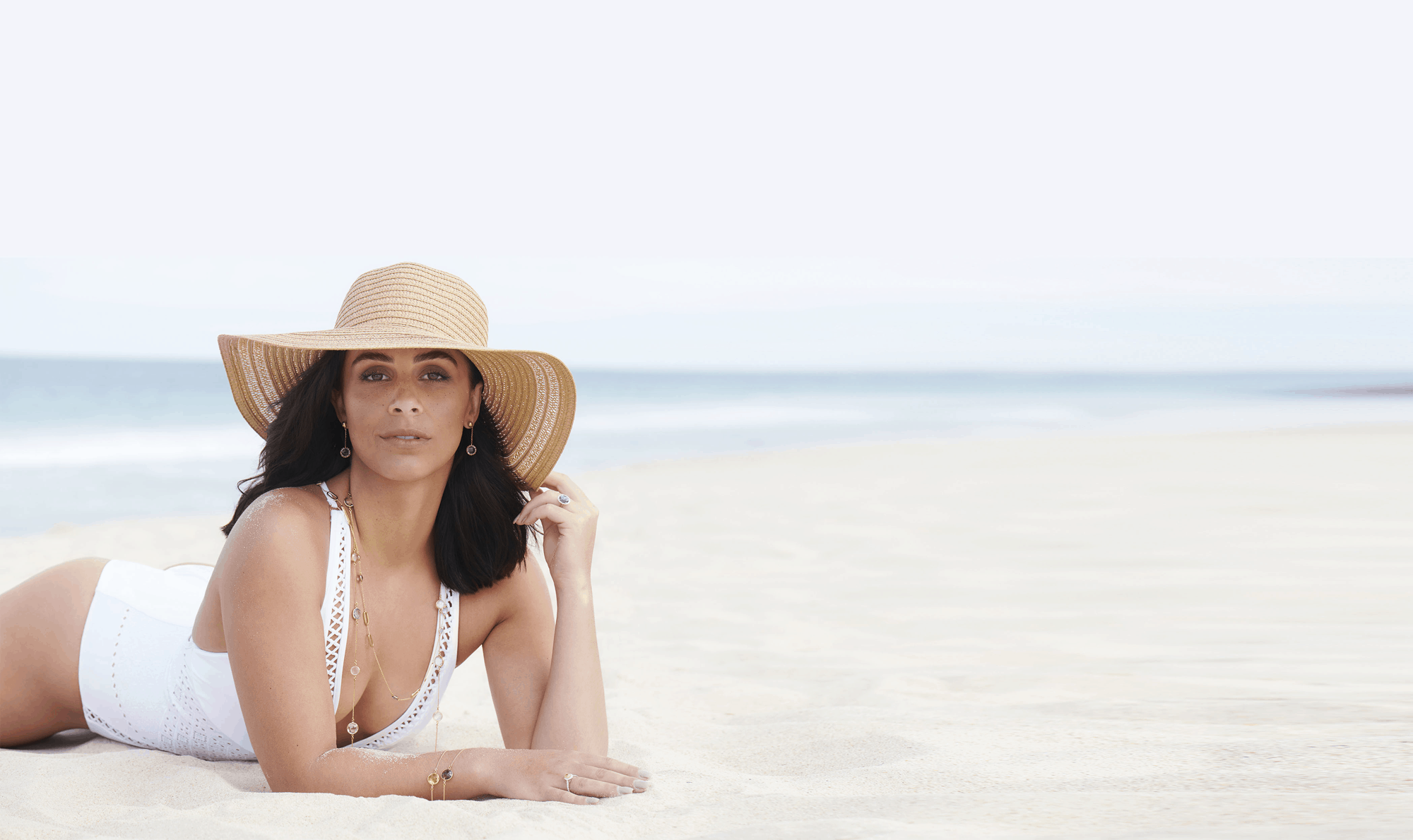 woman in beach wearing jewellery
