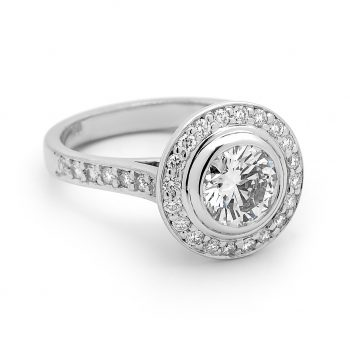 round brilliant diamond bezel set centre, pave halo ring by Stelios Jewellers in Perth